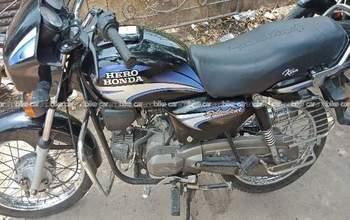 Hero Splendor Plus Self Start Drum Brake Alloy Wheel Rear View